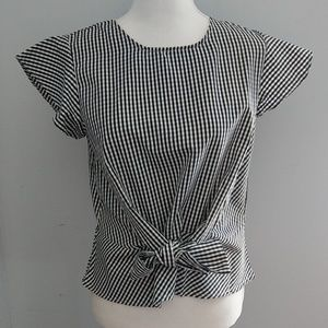 Gingham top with flutter sleeve and wrap waist